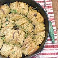 These crispy roasted potatoes are thinly sliced, layered with shallots, brushed with butter and oil, and cooked until golden brown and crispy. From @NevrEnoughThyme https://www.lanascooking.com/crispy-roasted-potatoes/