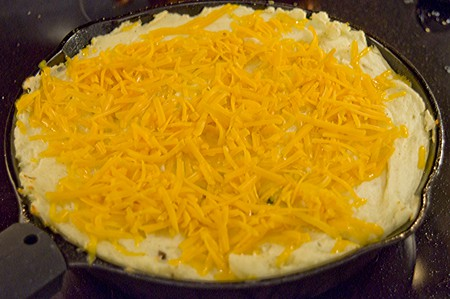 Adding cheese to top of Shepherd's Pie