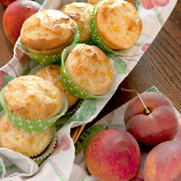 These Peaches and Cream Muffins are great for a light breakfast or snack. The batter which is rich with sour cream and butter makes up in minutes. https://www.lanascooking.com/peaches-and-cream-muffins/