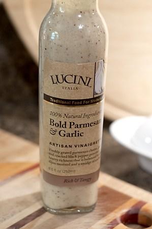 Bottle of parmesan and garlic salad dressing.
