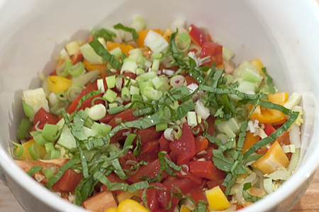 Small mixing bowl containing salad ingredients.