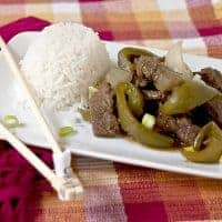 Steak and Peppers is a go-to meal for busy weeknights. Braised round steak with green peppers and onions is served with steamed white rice. https://www.lanascooking.com/steak-and-peppers/