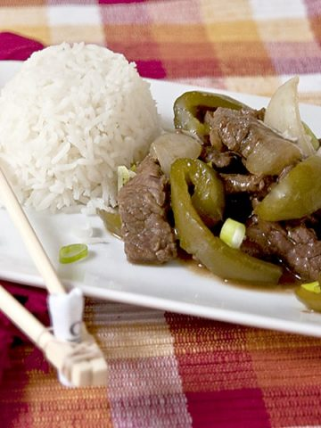 Steak and Peppers is a go-to meal for busy weeknights. Braised round steak with green peppers and onions is served with steamed white rice. From @NevrEnoughThyme https://www.lanascooking.com/steak-and-peppers/
