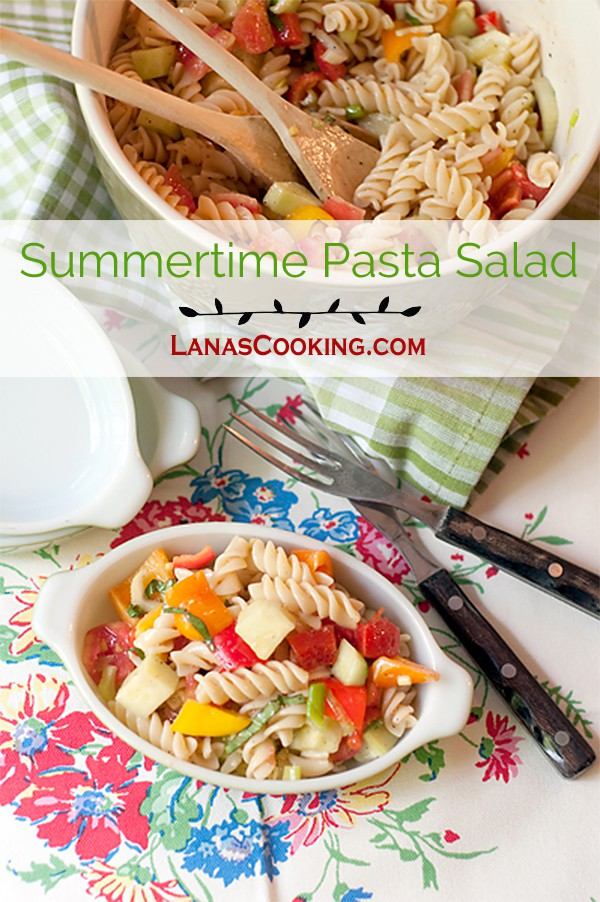Summertime Pasta Salad - A cold pasta salad packed with fresh veggies and lightly dressed with a parmesan and garlic dressing. Great summer side dish or picnic item. From @NevrEnoughThyme https://www.lanascooking.com/summertime-pasta-salad