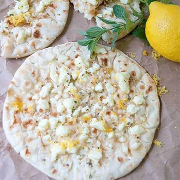 Sweet Greek Flatbread - flatbread topped with warm feta cheese, honey, lemon zest and oregano. Serve as an appetizer, snack, or light dessert. From @NevrEnoughThyme http://www.lanascooking.com/sweet-greek-flatbread/