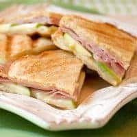 Ham Apple and Brie Panini - a lovely summer panini sandwich with good deli ham, crispy tart apple, creamy brie and the beautiful tang of Dijon mustard. From @NevrEnoughThyme https://www.lanascooking.com/ham-apple-and-brie-panini/