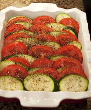 Creating the layers of tomato and zucchini