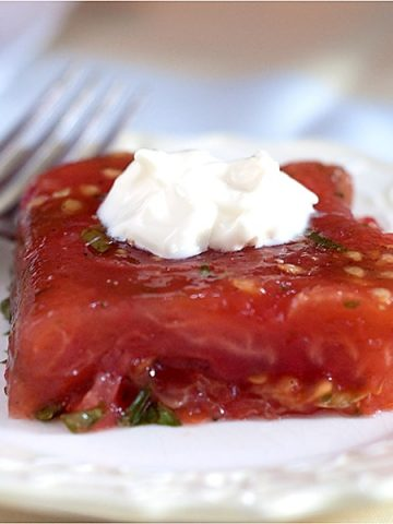 Old fashioned Tomato Aspic with fresh tomatoes, celery, and parsley in gelatin. Serve your guests this most classic of recipes for a real treat. From @NevrEnoughThyme https://www.lanascooking.com/tomato-aspic/