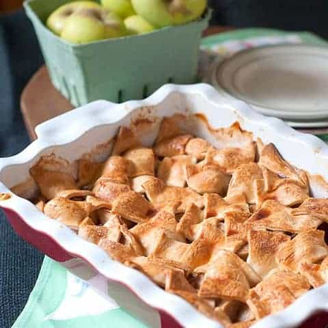 Apple Patchwork Cobbler - A delicious cobbler containing apples, cinnamon, cardamom and orange liqueur topped with a patchwork style crust. From @NevrEnoughThyme https://www.lanascooking.com/apple-patchwork-cobbler/