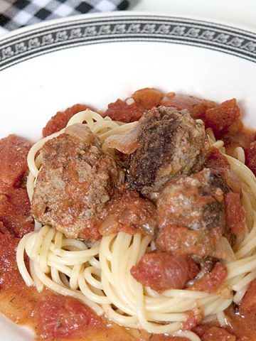 Meatballs in Creamy Tomato Dill Sauce - a fresh take on meatballs and spaghetti with lemon zest in the meatballs and dill and cream in the tomato sauce. From @NevrEnoughThyme https://www.lanascooking.com/meatballs-in-creamy-tomato-dill-sauce/