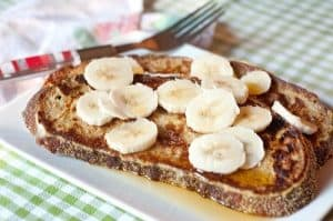 Banana Maple French Toast - whole grain French toast topped with sliced bananas and maple syrup. https://www.lanascooking.com/banana-maple-french-toast