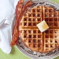 Whole Wheat Waffles - my classic recipe for healthier breakfast waffles. For variety, add fresh fruit or go savory with crumbled bacon and cheese. https://www.lanascooking.com/whole-wheat-waffles/