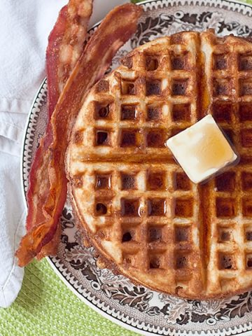 Whole Wheat Waffles - my classic recipe for healthier breakfast waffles. For variety, add fresh fruit or go savory with crumbled bacon and cheese. From @NevrEnoughThyme https://www.lanascooking.com/whole-wheat-waffles/