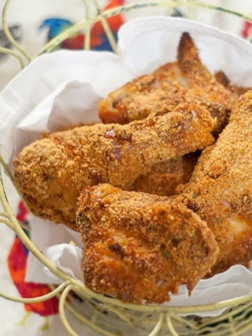 Buttermilk Baked Chicken - Chicken marinated in buttermilk and seasonings, coated with corn flake crumbs and Parmesan cheese and baked until crunchy. From @NevrEnoughThyme https://www.lanascooking.com/buttermilk-baked-chicken