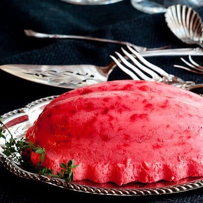 Polly's Pink Stuff - A retro recipe for a festive raspberry jello mold. From @NevrEnoughThyme http://www.lanascooing.com/pollys-pink-stuff-raspberry-jello-mold/