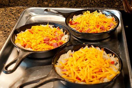 Add cheese to skillets