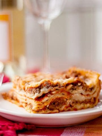 My Best Ever Lasagna - layers and layers of lasagna noodles with ricotta and mozzarella cheeses, Marinara and meat sauce. From @NevrEnoughThyme https://www.lanascooking.com/lasagna/