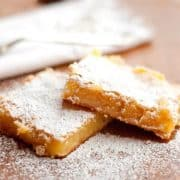 Rich and buttery Lemon Bars made with Meyer lemon juice and zest. A delicious afternoon treat with a cup of tea or coffee. https://www.lanascooking.com/lemon-bars/