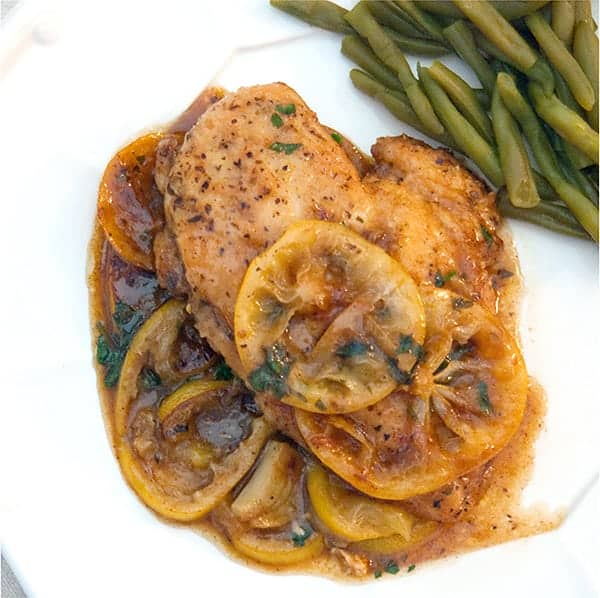 Meyer Lemon Chicken - delicious pan-fried chicken dressed in a Meyer lemon and garlic sauce. From @NevrEnoughThyme https://www.lanascooking.com/meyer-lemon-chicken/