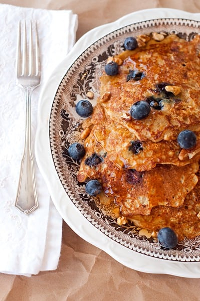 Oatmeal Blueberry Pancakes - These hearty oatmeal blueberry pancakes are packed full of whole grain oatmeal, blueberry, orange zest, and pecans. From @NevrEnoughThyme http://www.lanascooking.com/oatmeal-blueberry-pancakes
