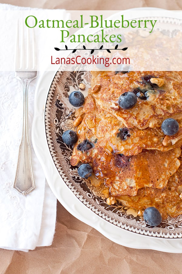 These hearty Oatmeal Blueberry Pancakes are packed full of whole grain oatmeal, blueberry, orange zest, and pecans. From @NevrEnoughThyme https://www.lanascooking.com/oatmeal-blueberry-pancakes/
