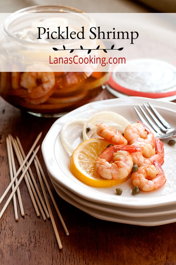 Pickled shrimp - Boiled shrimp layered with lemon slices, onion, and capers and marinated in cider vinegar. Serve with cocktail sauce on the side. From @NevrEnoughThyme https://www.lanascooking.com/pickled-shrimp/