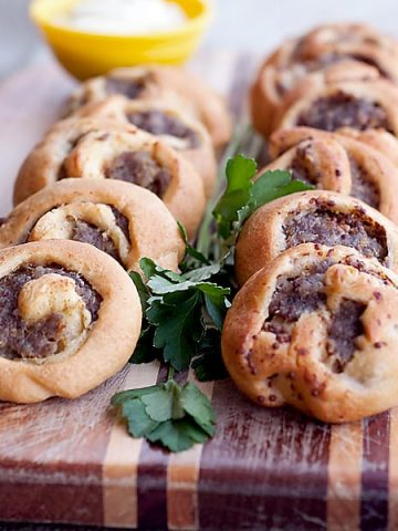 These Sausage Swirls use purchased crescent roll dough spread with mustard and sausage to make a fantastic appetizer for any occasion. https://www.lanascooking.com/sausage-swirls/