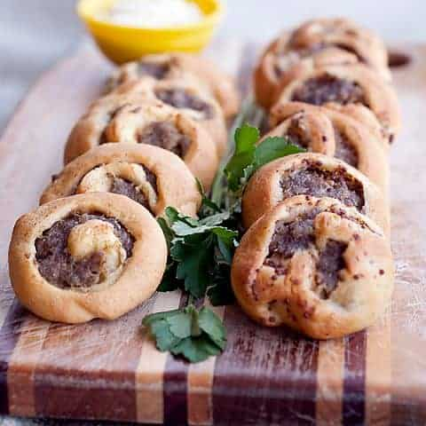 These Sausage Swirls use purchased crescent roll dough spread with mustard and sausage to make a fantastic appetizer for any occasion. From @NevrEnoughThyme https://www.lanascooking.com/sausage-swirls/