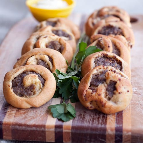 Sausage Swirls - These sausage swirls use purchased crescent roll dough spread with mustard and sausage to make a fantastic appetizer for any occasion. From @NevrEnoughThyme http://www.lanascooking.com/sausage-swirls