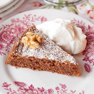 Flourless Walnut Cake - this flourless cake uses ground walnuts in place of flour and beaten egg whites for lift and is flavored with chocolate and coffee. https://www.lanascooking.com/flourless-walnut-cake/