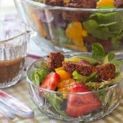 This spring salad with strawberries, full of lovely fresh flavors, is tossed with a sweet balsamic dressing, croutons, and Parmesan cheese. https://www.lanascooking.com/spring-salad-with-strawberries-and-sweet-balsamic-dressing/