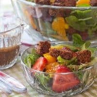 This spring salad with strawberries, full of lovely fresh flavors, is tossed with a sweet balsamic dressing, croutons, and Parmesan cheese. From @NevrEnoughThyme https://www.lanascooking.com/spring-salad-with-strawberries-and-sweet-balsamic-dressing/