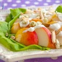 This Fresh Pear Salad with Blue Cheese Dressing is composed of sliced pears topped with tangy blue cheese dressing and toasted slivered almonds. From @NevrEnoughThyme https://www.lanascooking.com/pear-salad-with-blue-cheese-dressing/