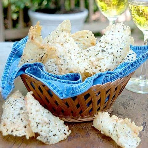 Asiago Cheese Crisps - Crispy chips of baked asiago cheese, minced sage, and chopped pine nuts. From @NevrEnoughThyme https://www.lanascooking.com/asiago-cheese-crisps/