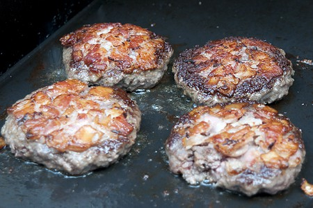 Burgers after cooking on one side