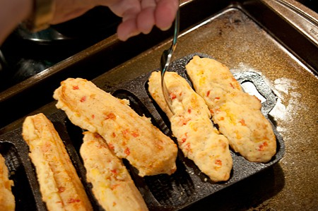 Loosen the corn sticks from the pan