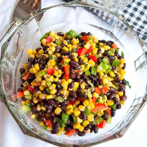 Low in fat, high in flavor, with a healthy dose of protein from the beans, this Black Bean and Corn Salad is a tasty side for a picnic. From @NevrEnoughThyme http://www.lanascooking.com/black-bean-and-corn-salad/