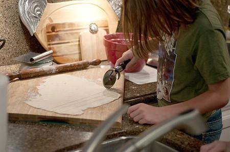 Aidan cutting dumplings
