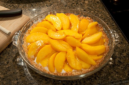 Add sliced peaches on top of filling