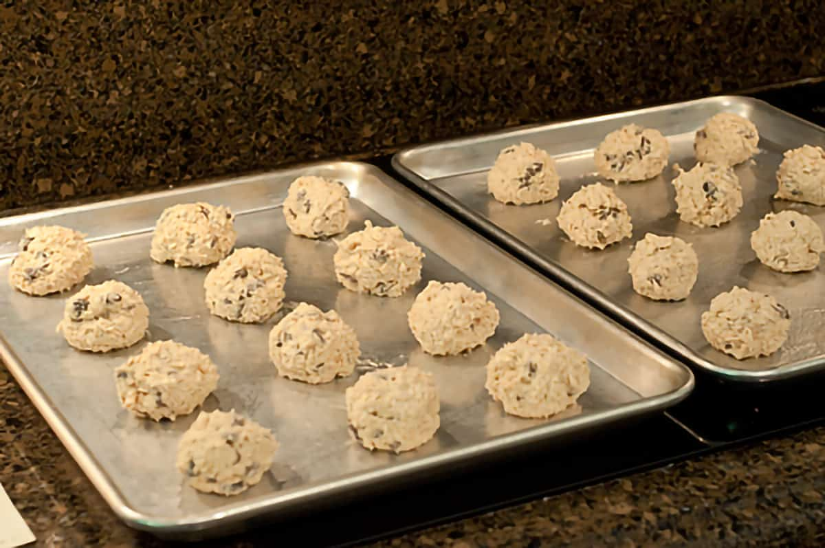 Scoops of cookie dough on baking sheets