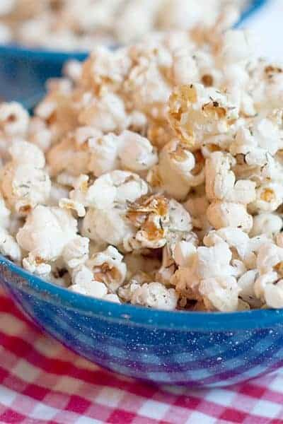 Offer your guests a bowl of Garlic Butter and Herb Popcorn. It's popcorn coated with garlic infused butter and tossed with herbs and celery seed. From @NevrEnoughThyme https://www.lanascooking.com/garlic-butter-and-herb-popcorn/