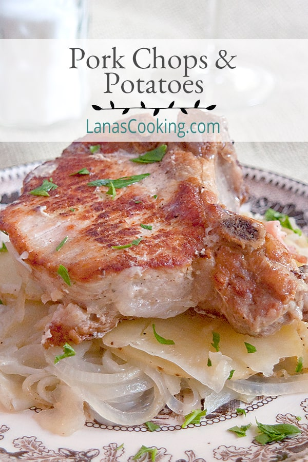 Pork Chops with Potatoes - a very old French recipe for slow cooked pork chops, onions, and potatoes. Melt in your mouth delicious! From @NevrEnoughThyme https://www.lanascooking.com/pork-chops-with-potatoes/