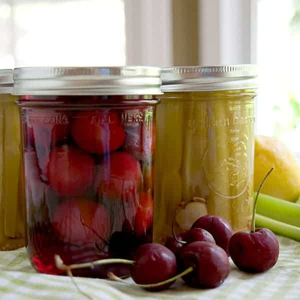 Tart Pickled Cherries and Pickled Celery Sticks - two unusual homemade pickles to accompany drinks, antipasto, or charcuterie. From @NevrEnoughThyme https://www.lanascooking.com/tart-pickled-cherries-and-pickled-celery-sticks/