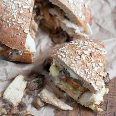 Chicken, Bacon, and Mushroom Sandwich on a whole grain boule, with garlic mayonnaise and layered with bacon, brie, caramelized onions, and mushrooms. From @NevrEnoughThyme https://www.lanascooking.com/chicken-bacon-mushroom-sandwich/