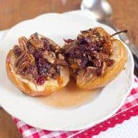 Baked Apples with Cranberries and Pecans make the perfect Fall treat! Serve alone or topped with a drizzle of cream or small scoop of vanilla ice cream. From @NevrEnoughThyme https://www.lanascooking.com/baked-apples-with-cranberries-and-pecans