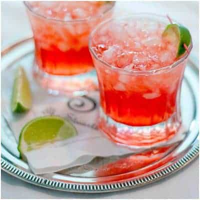 A Scarlett O'Hara cocktail containing Southern Comfort, cranberry juice, and lime juice. Just the thing for a southern celebration. From @NevrEnoughThyme https://www.lanascooking.com/celebrating-with-creative-culinary-scarlett-ohara-cocktail/