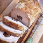 Sliced Apricot and Prune Stuffed Pork Loin on a serving tray.