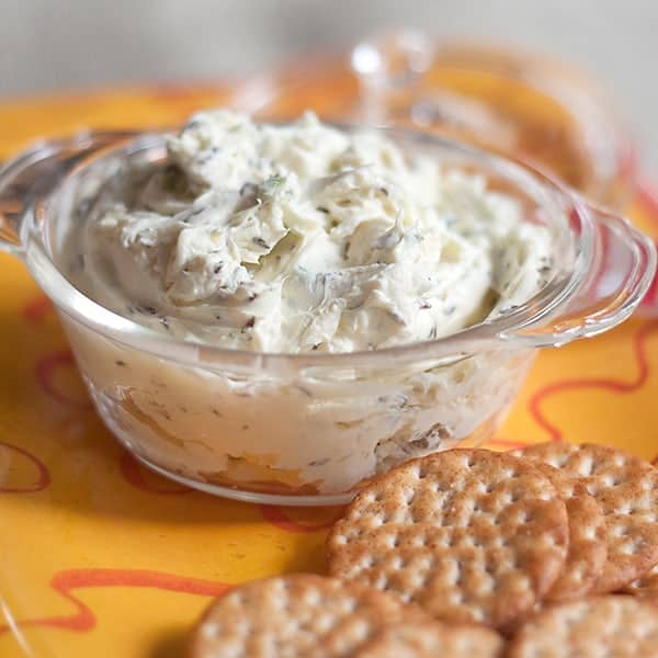 Caraway Cheese Spread - A simple, delicious cheese spread great for any get together. Serve with an assortment of crackers. From @NevrEnoughThyme https://www.lanascooking.com/caraway-cheese-spread/