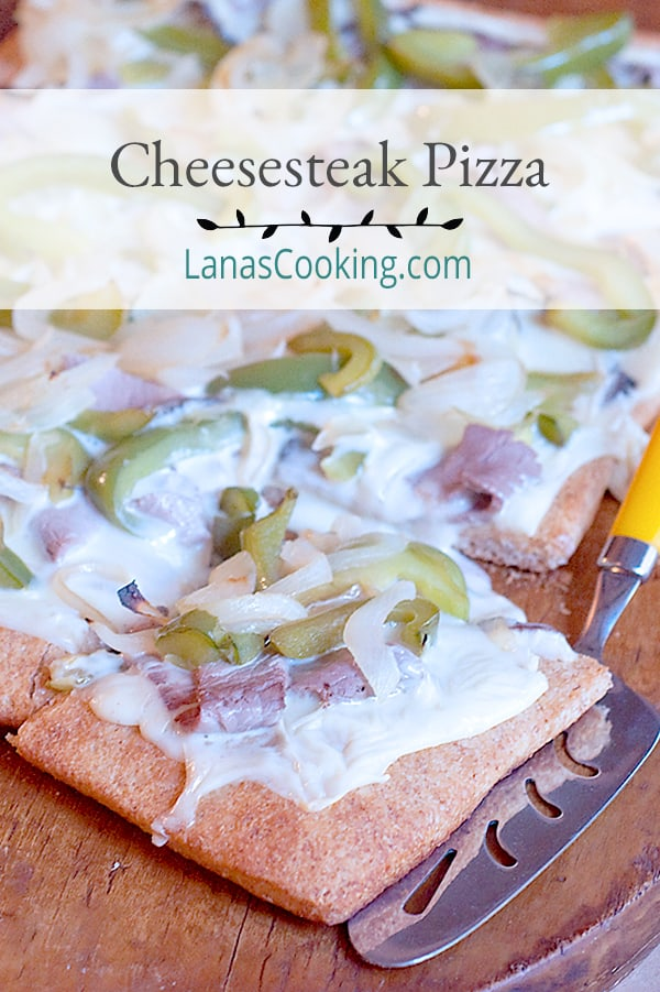 Cheesesteak Pizza - a quick and easy cheesesteak style pizza with a convenient refrigerated pizza crust and roast beef from the deli. From @NevrEnoughThyme https://www.lanascooking.com/cheesesteak-pizza/