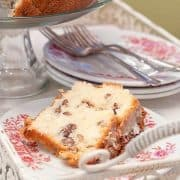 This White Chocolate Cake is a delicious, decadent, comfort food cake rich with butter and full of white chocolate, pecans, and coconut. https://www.lanascooking.com/white-chocolate-cake/